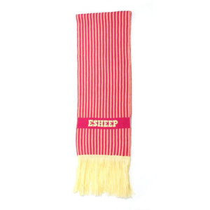 "A narrow rectangular scarf shown folded in half. It has narrow pink and pale coral vertical stripes and pale yellow fringing at the end. An horizontal pink stripe features the word ""ESHEEP"" in pale yellow letters, situated approximately ten centimetres from the edge."