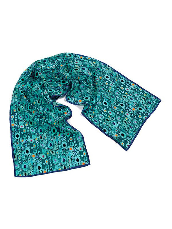 A turquoise rectangular scarf, covered in a random pattern of small light blue circles of various sizes, with different dark colours in the centre of the circles.