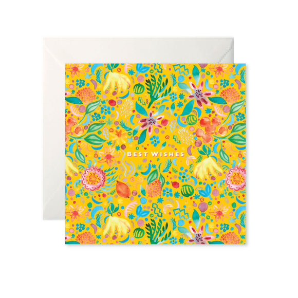 A yellow card with a colourful painted pattern of fruits and flowers. 'Best Wishes' is in the centre in white capital letters.