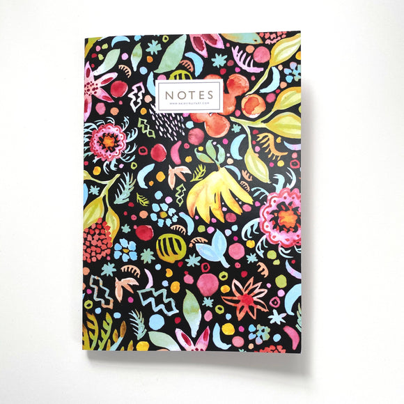 A black notebook cover with a colourful painted pattern of fruits and flowers. 'Notes' is centred at the top in capital letters.