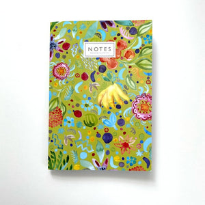 A green notebook cover with a colourful pattern of painted fruits and flowers. 'Notes' is centred at the top in capital letters.