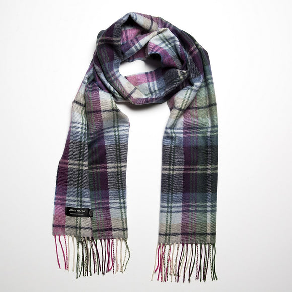 A dark grey scarf checked with pink, green and pale blue, with a matching fringe across both ends.