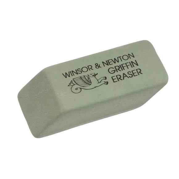 A muted sage green eraser, shaped like a rectangle with sloped sides. The name and a simple line drawing of a griffin are in black on top of the eraser.