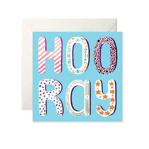 A blue card with 'Hooray' written in large bubble letters, taking up the whole card. Each letter has a different pattern inside such as stripes, dots or stars.