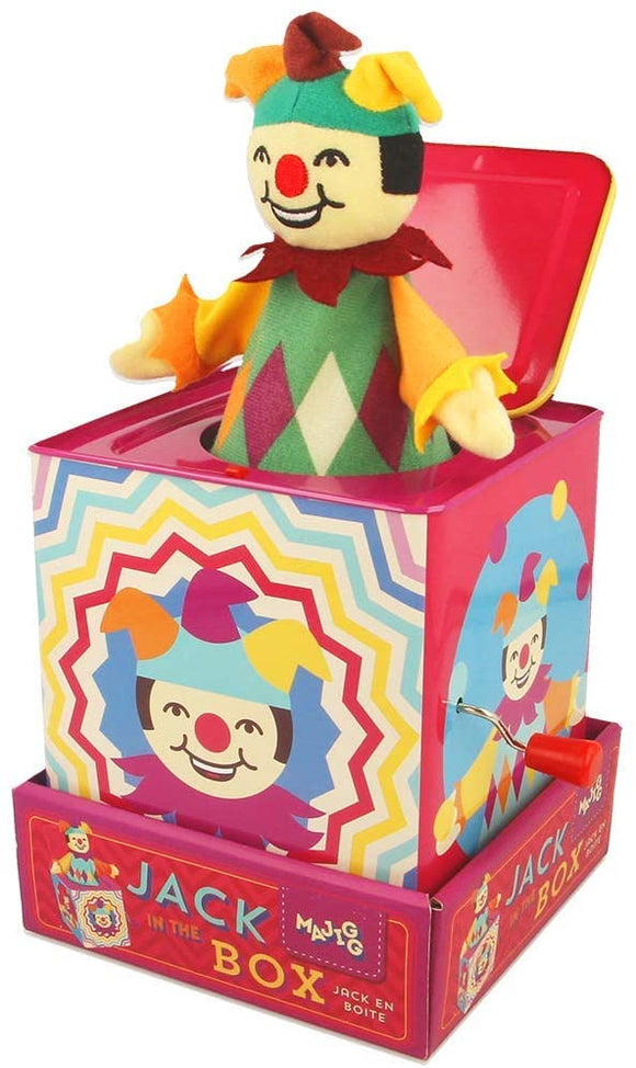 A colourful tin with a soft toy jester poking out of the open lid. Each side of the tin is a different illustration of a jester. A silver and red handle is attached to one side.