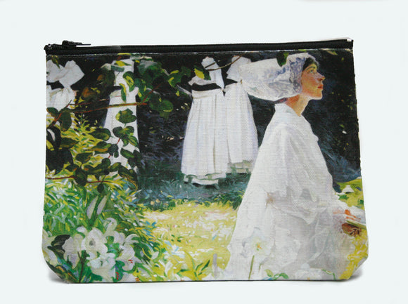 A zip top bag with a woman in white walking through a garden with leaves and lilies to the left.