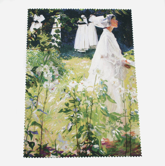 A woman in white walks towards the right of the image. White, long stemmed lilies dominate the foreground and up the left side of the image, effectively framing the woman. The cloth has zig zag edges.