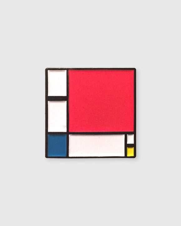 The square pin is primarily taken up by a large red square starting from the top left corner which covers about two thirds of the image. The rest of the pin has white rectangles separated by black lines with one blue and one yellow square.