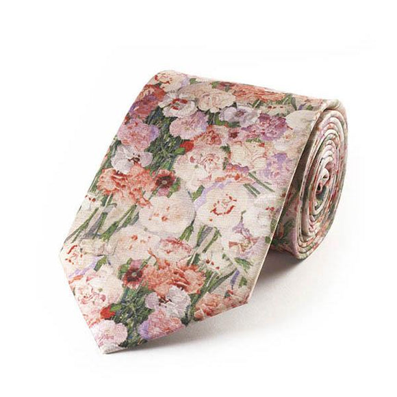 A partially rolled up tie covered in a pattern of pink painted flowers.