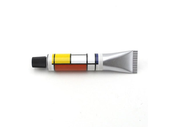 The tube is silver with a black lid. The top half of the pen is wrapped in a typical Mondrian image of white, red, black, blue and yellow rectangles separated by black lines.