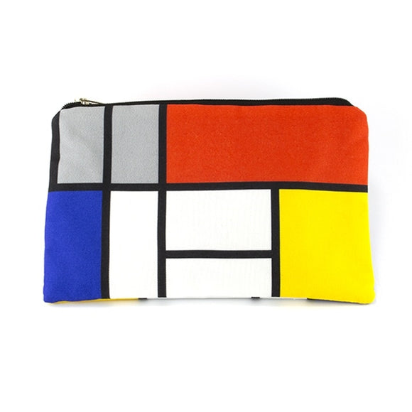 A rectangular zip top pouch with a design of white, red, black, blue, yellow and grey squares and rectangles separated by black lines.