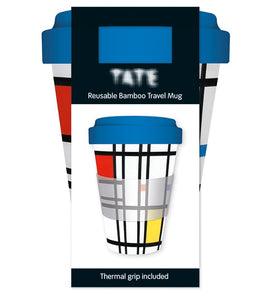 A travel mug with a design primarily of white squares and rectangles separated by black lines. There are some red, yellow and blue squares. The lid is a matching blue. It is in it's packaging. The label shows the mug and the Tate logo.