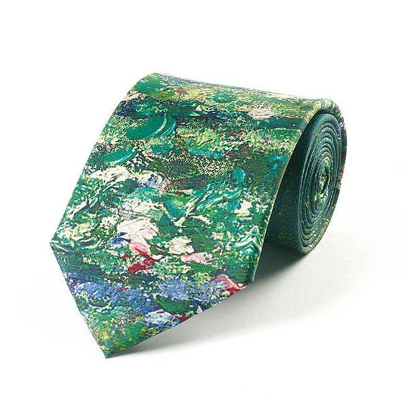 A partially rolled up tie with a look of green painted texture. At the bottom are lily pads and white lily flowers on water.