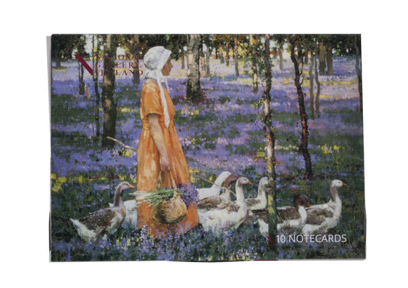 The pack cover is a woman in an orange dress and white bonnet walks through a woods where the forest floor is covered in purple flowers. She has a group of geese around her and carries a basket of the purple flowers.