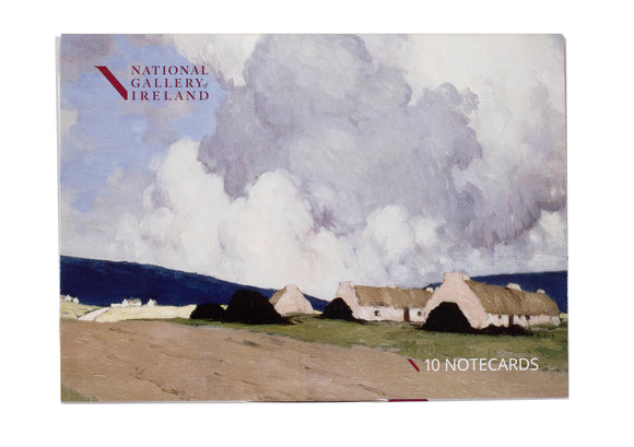 The pack cover is a painting of a large, cloudy sky while the bottom third is a few cottages boarding a dirt road.