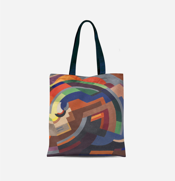 A bag with long navy handles covered in an abstract image of various shapes making a curve, primarily in shades of orange, blue and green.