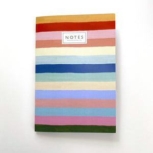 A notebook with horizontal painted stripes of different colours. 'Notes' is centred at the top in capital letters.