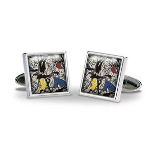 A set of square silver cufflinks with an image in the centre of black paint splatter with dashes of red, yellow and blue.