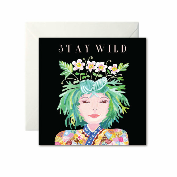 A black card with a drawing of a woman from the shoulders up. She has green hair with flowers growing from the top. 'Stay Wild' is written in white capital letters at the top.