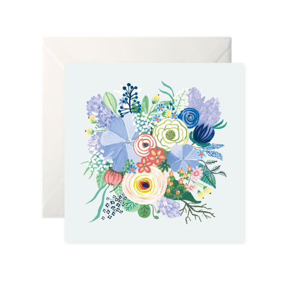 A pale, grey blue card with a large, colourful drawing of a bouquet of flowers in the centre.