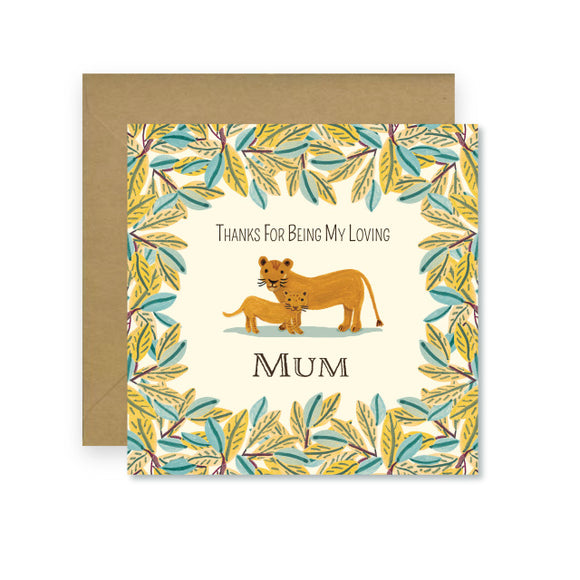 A cream card with a thick border of green leaves. In the centre is a drawing of a mother and baby lion. 'Thank you for being my loving mum' is written in capital letters around the lions.