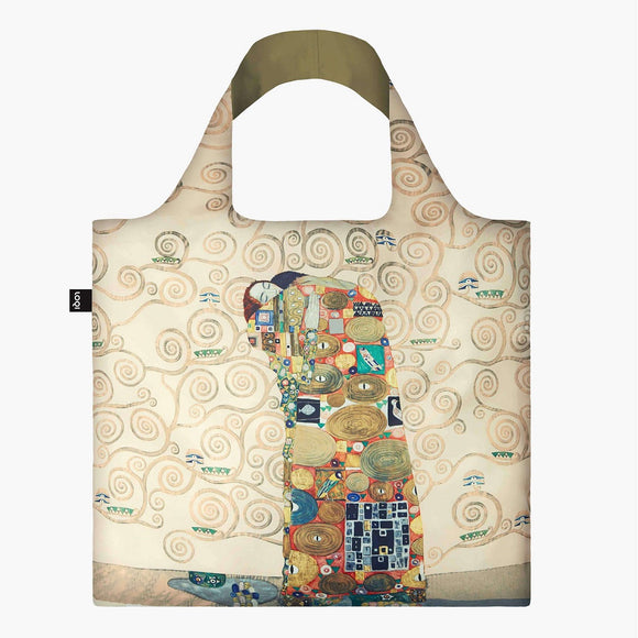 A square bag with an illustration of a couple embracing in the centre. They are covered in a pattern of squares and circles in gold, red, yellow and touches of blue. There are swirls against the cream background. The handle lining is a matching gold.