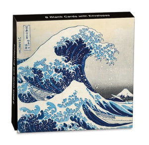 A box with an illustration of a large wave about to crash over the sea on the front.