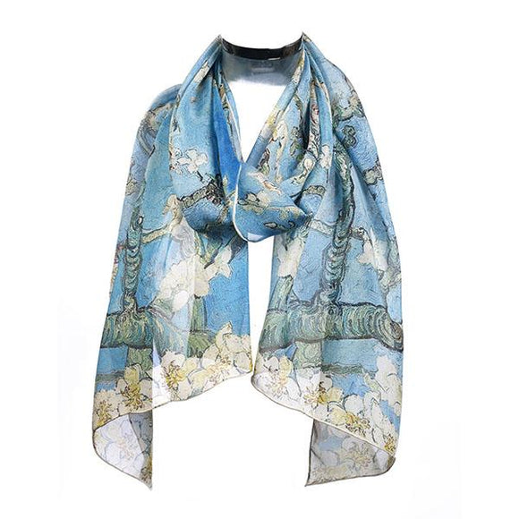 A light blue scarf draped around an invisible neck. Across the scarf is a pattern of branches with white flowers. The paint texture is visible.