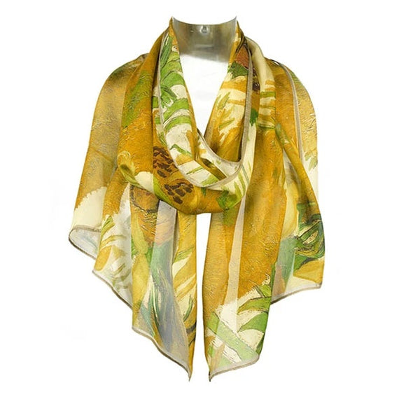 A scarf primarily in shades of yellow with touches of green draped around an invisible neck.