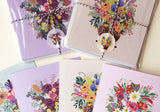 Multiple packs of cards with drawings of flower bouquets in clear wrap, tied with red and white string.