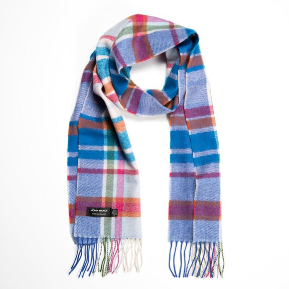 A red and blue checked scarf with stripes of pink, green and white, with a matching fringe across both ends.