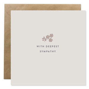 A light grey card with 'With deepest sympathy' written in black capitals in the centre. Above is a silhouette of flowers in a warm grey.