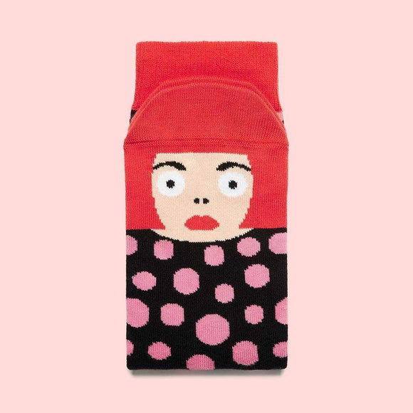 A folded sock with a cartoon illustration of a woman with red hair and lips on the foot part.