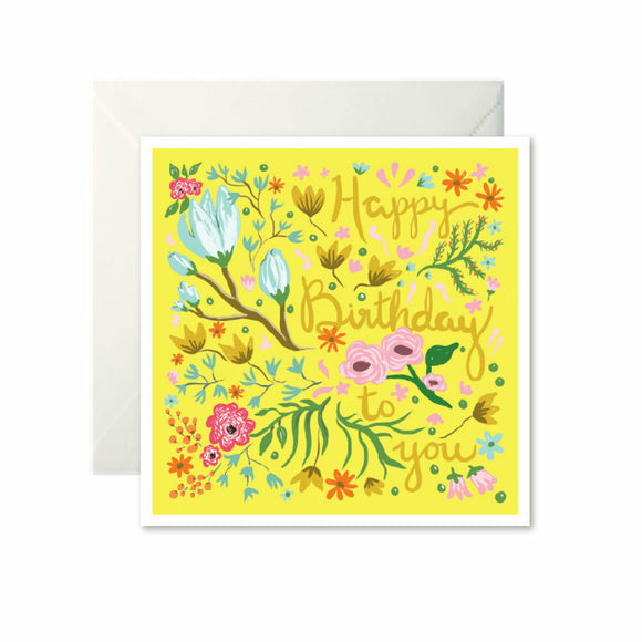 A bright yellow card with drawings of flowers. 'Happy birthday to you' is written down the left in dark yellow cursive, mixed in with the flowers.