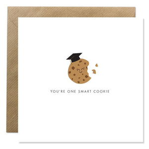 A white card with a drawing of a smiling cookie wearing a graduation hat. 'You're one smart cookie' is written in black capitals underneath.