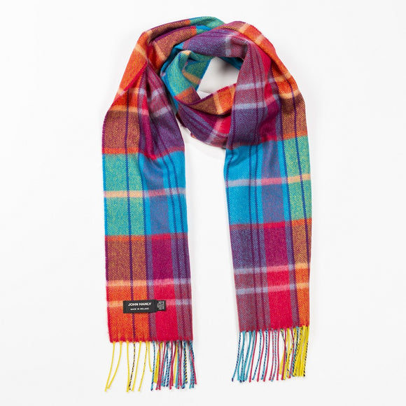 A scarf in a bright tartan check pattern of orange, blue, red, and pink, with matching fringe hanging across the ends.