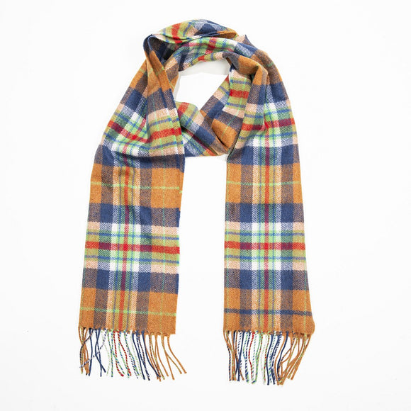 An orange scarf with an intricate check in navy, red and light green, with a matching fringe on both ends.