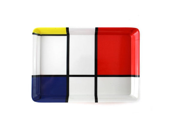 A rectangular tray with a design of white, red, blue, and yellow squares and rectangles separated by black lines.