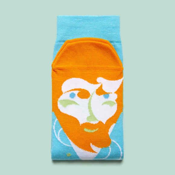 A folded sock with a cartoon illustration of a man with orange hair and beard on the foot part.