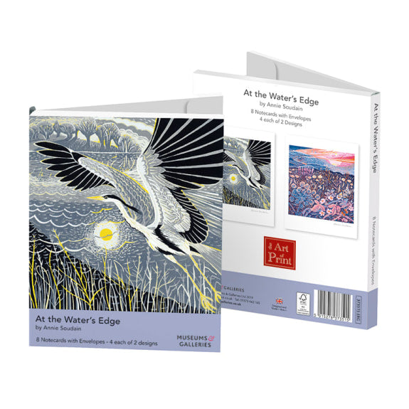 A white folding box with an illustration of a stork flying over a reed river bank. There is a lilac bar across the bottom with the product's details. The back of the box shows the two cards, the other a colourful landscape, and the products details.