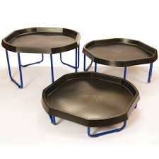 3 black active world trays on top of 3 adjustable active world tray stands at varying heights.