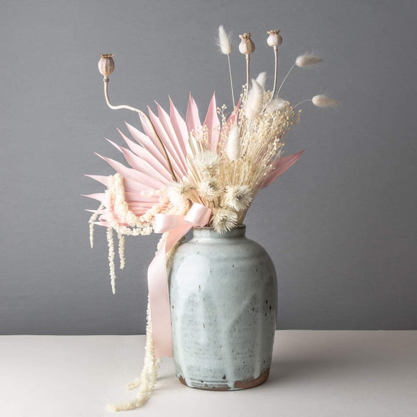 Baby blue vase with dried flowers