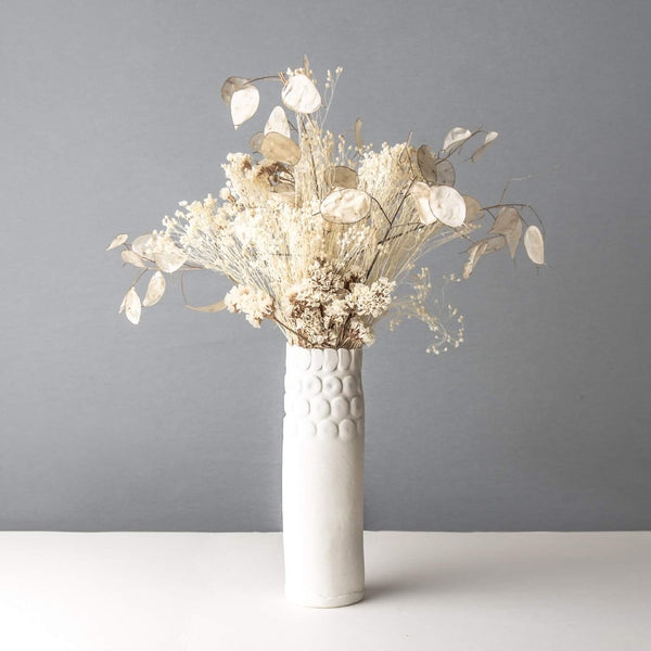 Slim porcelain vase with dried flowers