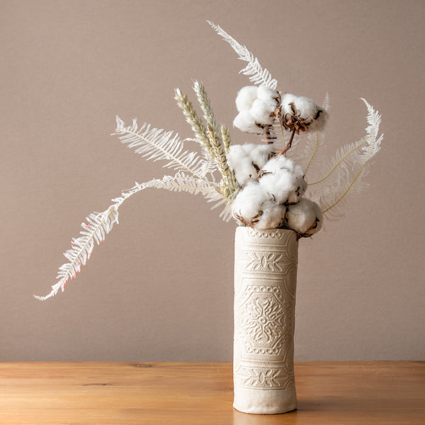 White Lace patterned vase with dried flowers