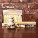 Load image into Gallery viewer, Help save the planet while doing the dishes! Our eco-friendly wooden pot brush is the handy solution to scrub your pots, pans and plates! Ideally shaped to fit in your hand, this sweet little brush will look cute on your counter top and is made from certified beech wood with vegan plant-based bristles.