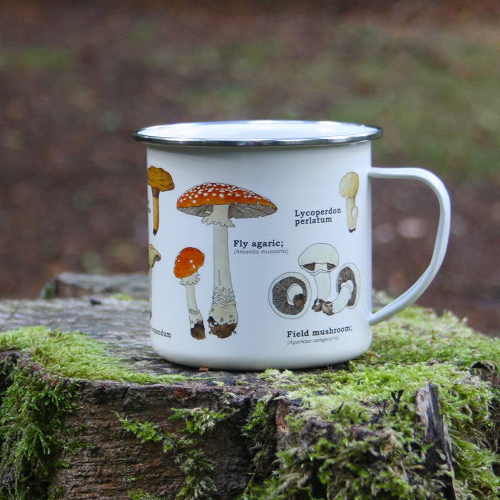 We are in love with our ecology enamelware mugs! Mushrooms of all shapes and sizes adorn this classically illustrated enamel mug. Any forager's best friend! These mugs are a perfect eco-friendly alternative to disposable cups. Available in a range of styles! Bring the magic of the outdoors in, or embrace nature or take it with you!
