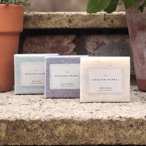 Our English Flora soaps are wrapped in parchment and made in Great Britain. This collection of Herb Border, Peppermint and Liquorice Root wrapped in our House ribbon makes the perfect gift for Christmas or any time of the year! (3 x 100g)