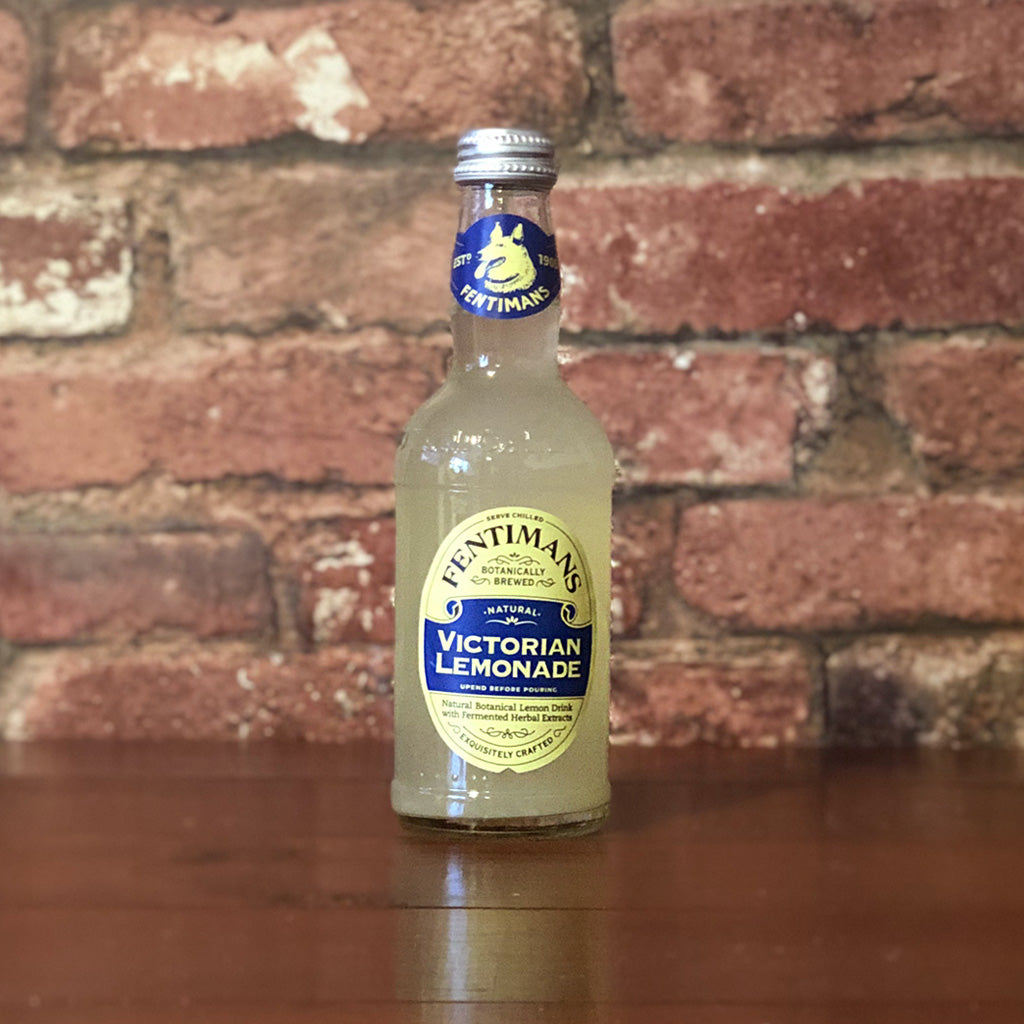 Natural botanical lemon drink with fermented herbal extracts in a glass bottle, sweet and refreshing!