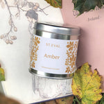 Load image into Gallery viewer, Part of the St. Eval Folk Collection, Amber is soft, warm and subtly honeyed with notes of almond and musk. A perfectly balanced sweeter candle - A sumptuous scent which conjures up Winter warmth, or perfect for cozy everyday relaxation.
