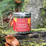 Load image into Gallery viewer, Our St. Eval Orange & Cinnamon candle is truly a sense of the season in a tin! An annual favourite - this warm and tangy fragrance perfectly balances sweet with a zesty spice and is sure to evoke that festive feeling!